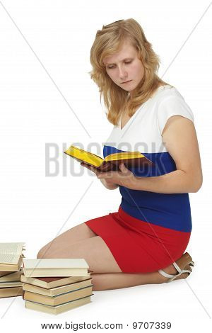 Girl Reads Lot Of Books Sitting On Floor