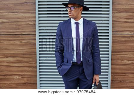Elegant businessman in suit, hat and eyeglasses