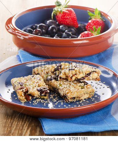 Healthy  Granola Bars  With Fresh Berries On A Plate.