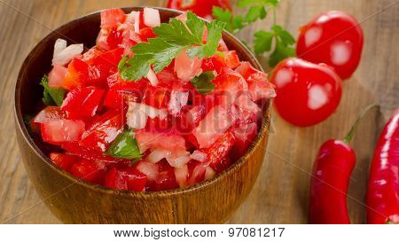 Fresh Salsa Dip On  Wooden Table.