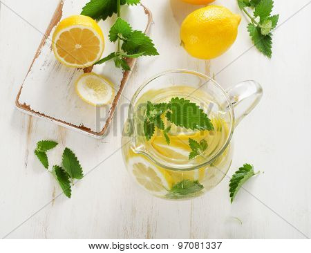 Water With Fresh Lemon And Mint Leaves