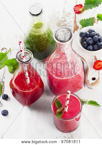 Healthy Fresh Smoothies With Berries On   Wooden Table.