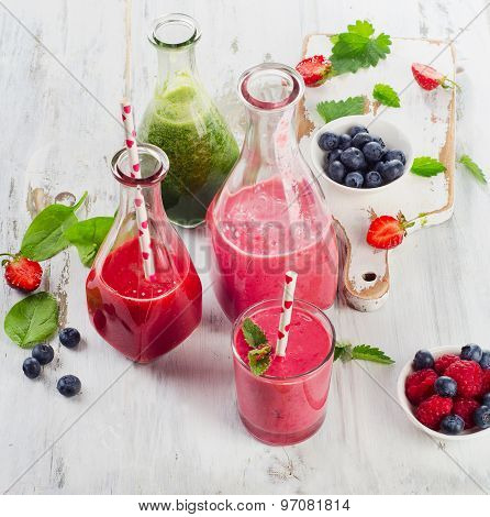 Healthy Fresh Smoothies On  A Wooden Table.