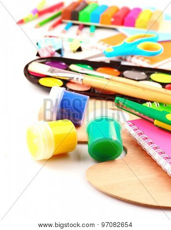 Colorful school stationery isolated on white