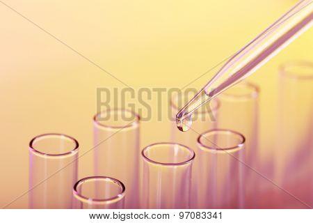 Test tubes on color background