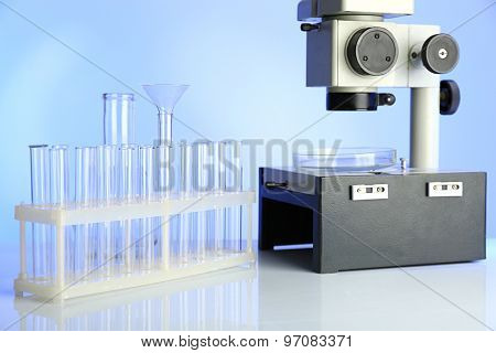 Test tubes and microscope in laboratory