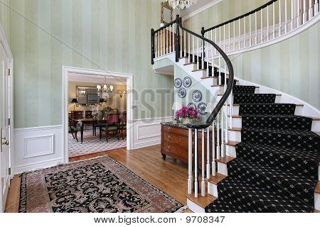 Foyer With Carpeted Staircase