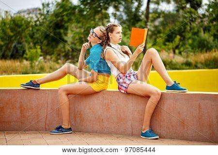 Best Friends Read Diary In Park.