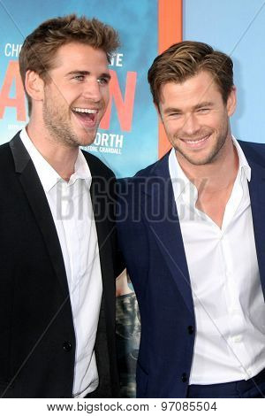LOS ANGELES - JUL 27:  Liam Hemsworth, Chris Hemsworth at the