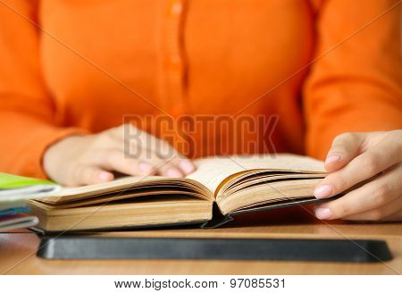 Student reading book, close-up