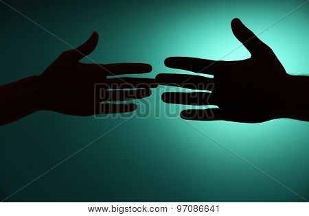 Silhouette of hands close up