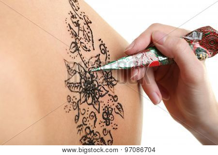 Process of applying Mehendi on female back, on white background