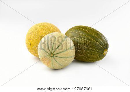 three fresh melons on white background