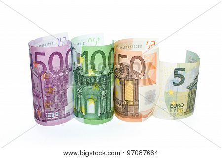 Euro Banknotes Of Various Denominations On A White Background
