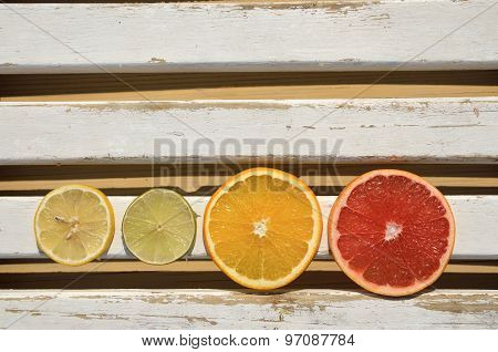 Citrus Slices On White Wooden Surface