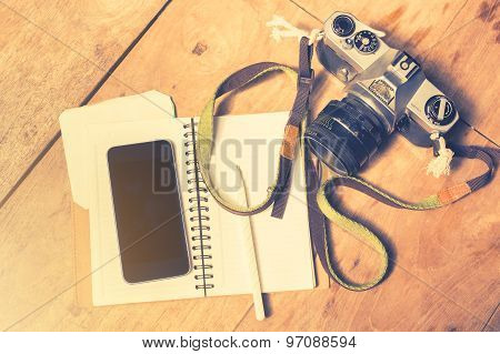 Cell Phone, Diary And Old Camera