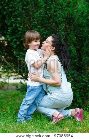 Loving mother hugging her son