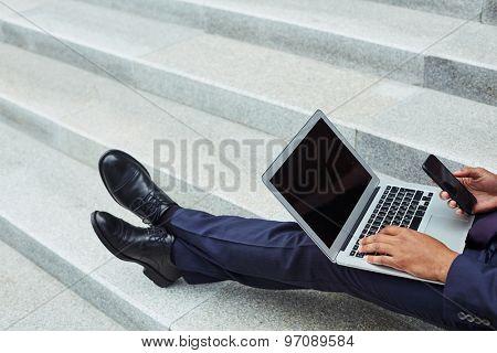 Modern employee using mobile gadgets