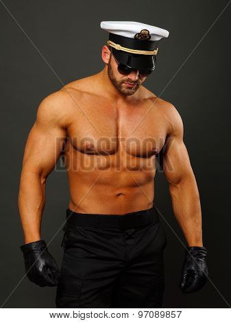 Muscular man in captain cap