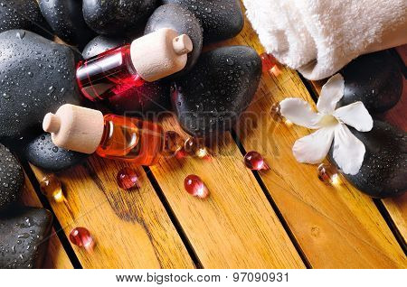 Containers And Oil Balls And Essences On Wooden Top View