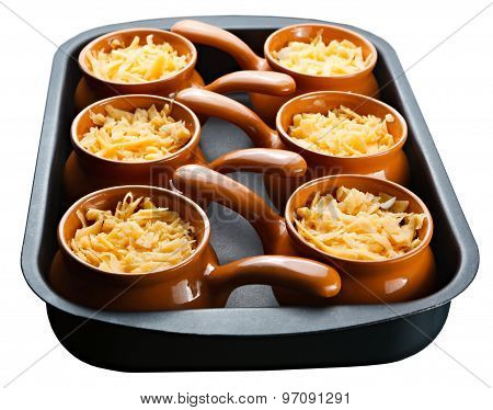 Roast With Vegetables, Meat And Cheese In Pottery. Isolation