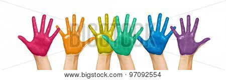 people, gay pride, creativity and art concept - palms of human hands painted in rainbow colors