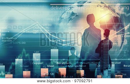 Back view of businesswoman and graphs at background