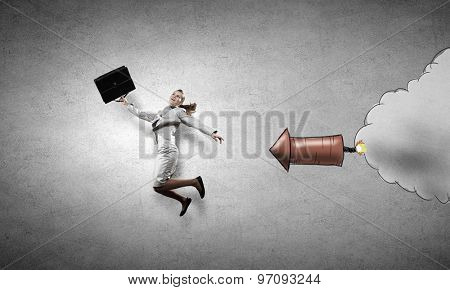 Young speedy businesswoman running in a hurry