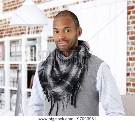 Portrait of stylish young black businessman, looking at camera.