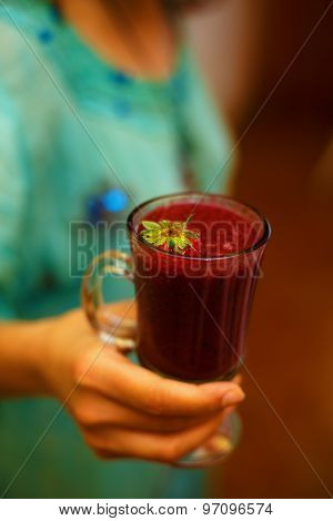 Fresh strawberry drink. Drink in woman hand.