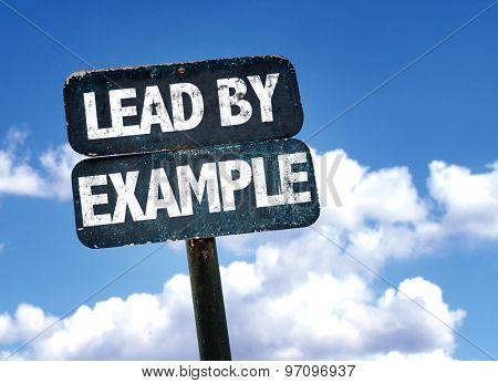 Lead By Example sign with sky background