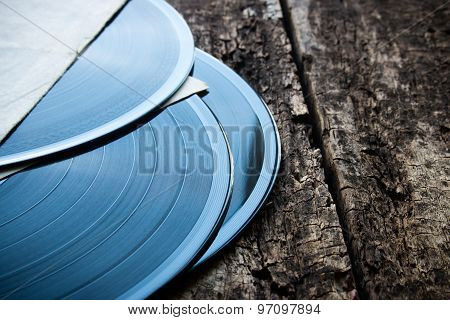 Three Vinyl Records On A Wooden Background