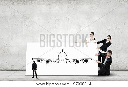 Young people holding white banner with airplane illustration
