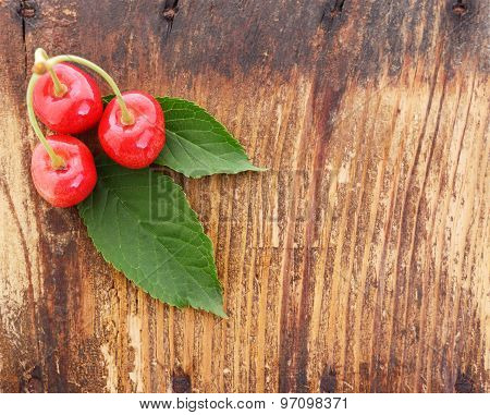 Cherries On Old Wooden Plank