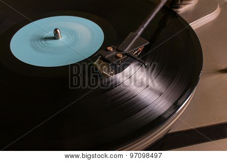 Rotating Vinyl Record With A Blue Mark On The Turntable Selective Focus