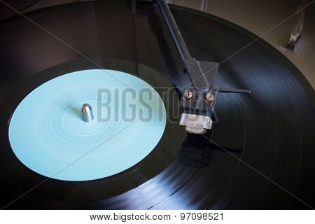 Rotating Vinyl Record With Blue Label On A Turntable Close-up Selective Focus
