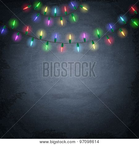 Colorful Glowing Christmas Lights On Chalkboard Background