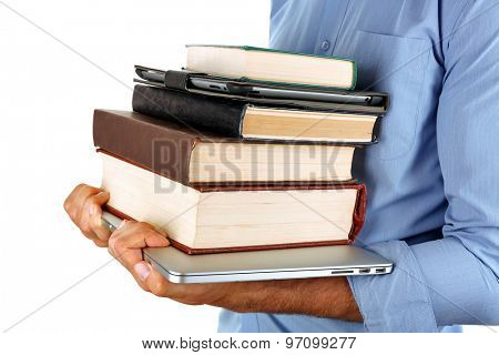Man holding stack of books with laptop and tablet isolated on white