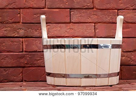 Bucket For A Bath On A Brick Surface. Equipment For Saunas