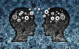 foto of headings  - Training neuroscience development concept as a group of cog wheels and gears shaped as human heads with information transfer as a technology brain symbol or psychology exchange success - JPG