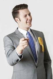 stock photo of politician  - Studio Portrait Of Untrustworthy Politician Winking At Camera - JPG