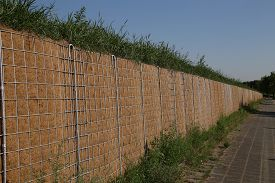 stock photo of noise pollution  - View of a noise protection wall on a street - JPG