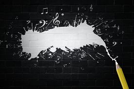 foto of musical scale  - Music notes and pencil on black background - JPG