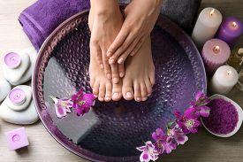 stock photo of wet feet  - Female feet at spa pedicure procedure - JPG
