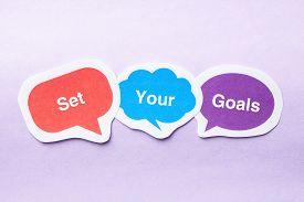 image of bubble sheet  - Set your goals concept paper bubbles against purple background - JPG