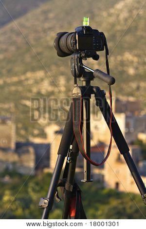 Camera on a tripod ready to shoot a landscape scenery in Mani, Greece