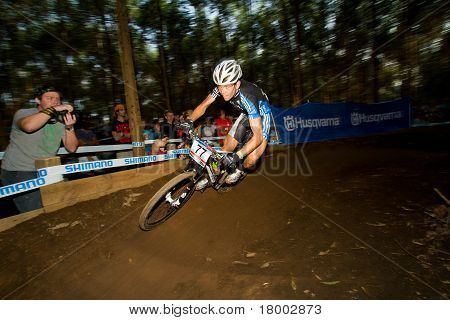 Motion Blur Uci Mtb World Cup Rider Taking Berm