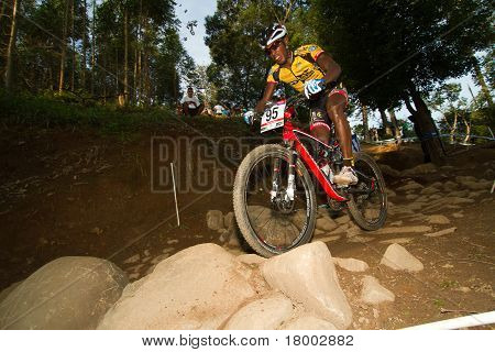 Wide Angle Of Rider In Uci Mtb World Cup Going Over Rocky Section