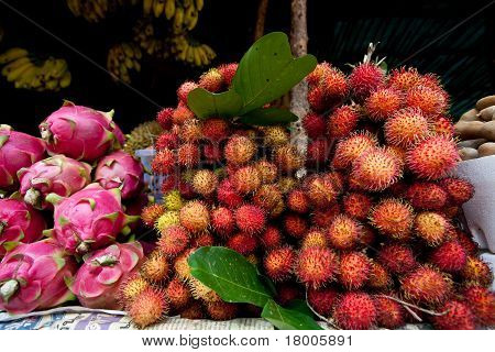 Close-up Of Dragon Fruit And Rambutan In Market