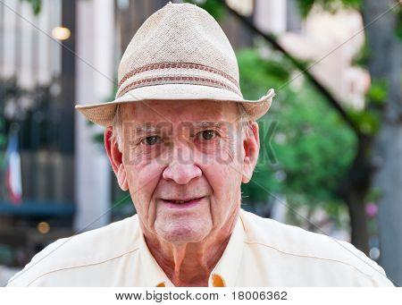Portrait Of Senior Man With Straw Hat